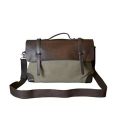 Stylish work bag made of leather and canvas with adjustable and detachable strap. Love the hidden magnetic closure.