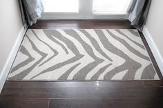This painted on plain tan rug. I'm considering trying it. I mean I dig zebra striped rugs a lot!!!