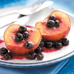 Grilled Peaches 'n' Berries Recipe -With only five ingredients, this delightful dessert is so easy to prepare. Just halve peaches and sprinkle with fresh blueberries and a brown sugar mixture. Because they're grilled in foil, there are no messy dishes to wash. —Sharon W. Bickett, Chester, South Carolina