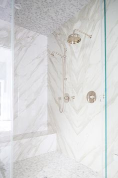 Walk-in shower boasts a polished nickel vintage exposed plumbing shower kit fixed to a bookmatched marble surround over marble grid floor tiles leading to a white and gray marble shower bench positioned beneath a marble grid tiled ceiling. Mosaic Shower Tile, Marble Mosaic, Bathroom Marble, Marble Showers, Shower Seat, Shower Kits, Bath Remodel, Beautiful Bathrooms, Bathroom Inspiration