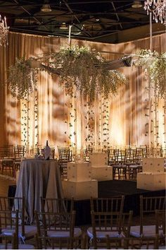 With hanging centerpieces, crystal chandeliers and gold accents, nothing falls short of glamorous at this Denver wedding venue. Aside from the elegant decor, exposed ceilings and brick walls add a stylish industrial vibe to this urban loft, making it perfect for a contemporary wedding. | The Studio Loft at Ellie Caulkins Opera House