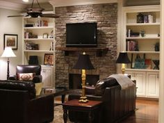 Great idea for the master suite's sitting room. Love the fireplace.