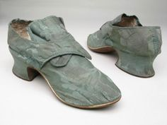Pair of woman's shoes, 1735-1765. Green damask satin, pointed toe. Strap fastening. Leather soles, broad heels.