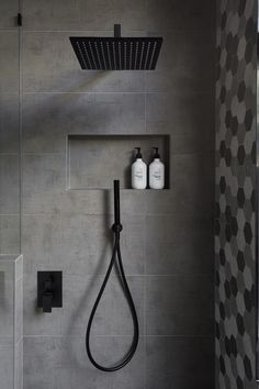 In this modern bathroom, the shower has a matte black rainfall shower head and a hand held shower head, as well as a tiled built-in shelf. - In this modern bathroom, the shower has a matte black rainfall shower head and a. Modern Bathroom Design, Bathroom Interior Design, Modern Bathrooms, Black Bathrooms, Bath Design, Master Bathrooms, Bathroom Designs, Shower Designs, Master Baths
