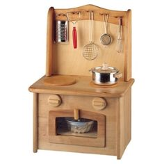 This beautiful natural alder wood stove made by quality toymaker Gluckskafer is feature-rich with hanging space for utensils a door that opens knobs turn. Childrens Wooden Kitchen, Wooden Play Kitchen Sets, Diy Kids Kitchen, Kitchen Sets For Kids, Childrens Kitchens, Toy Kitchen Set, Kitchen Stove, Stove Oven, Green Kitchen