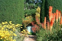 The theme of the Cottage Garden is red, yellow & orange. It was laid out between 1930 and 1931