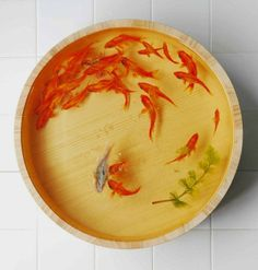Riusuke Fukahori paints incredibly realistic three-dimensional goldfish using acrylic paint layered over clear resin