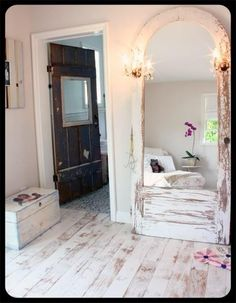 Old chippy door turned into a mirror & halltree!  Love the floor too!