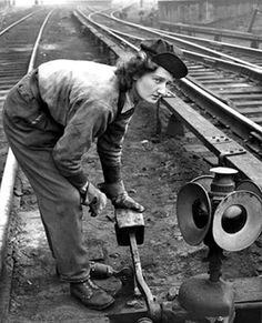 A young woman works as a switch tender at the Sunnyside Yard in Long Island City in the 1940s #vintage