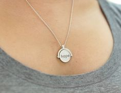 A modern day locket that uses NFC technology to link your precious photos, videos, apps, and more.