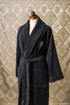 A chenille bathrobe with an embroidered black and silver rose on the breast pocket.