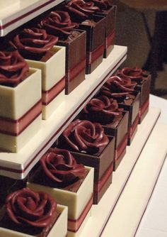 Chocolate mini cake boxes, each with a chocolate rose. Gorgeously decadent, rich chocolate cake and