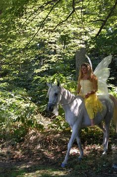 Sweetie the Unicorn and her Yellow Faerie at the Maryland Faerie Festival