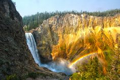 A rainbow can be seen in the waterfalls of Yellowstone National Park