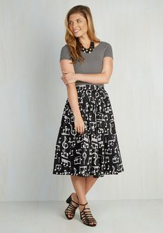 Fancy jazzing up your day with this black A-line, which boasts a pleated waistline paired with a melodic white print of music notes!