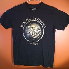 "Games of Thrones tee G.O.T tee shirt. Size large. Great condition. Direwolf of house Stark on the front with their house words ""winter is coming"". No holes, tears, rips or stains. Tops Tees - Short Sleeve"
