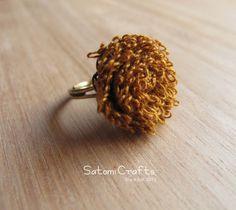 タティングレースの花の指輪です。綿素材の優しい風合のかわいらしい指輪です。サイズはフリーサイズです。【素材】   綿糸(brown), リング台(真鍮メッキ)... ハンドメイド、手作り、手仕事品の通販・販売・購入ならCreema。