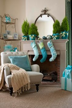 Decorating: Holiday Mantels There's nothing wrong with having a blue, blue Christmas when a neutral room begs for an alternative holiday color. Sparkly turquoise fabrics invigorate the space with their unexpectedly modern twist. Fresh greens tie together the icy hues with the room's palette of warm oatmeal and beige.:
