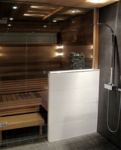 This stylish steam room has white Corian benches and large format ...