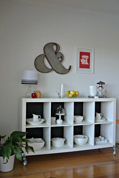 ikea expedit shelves as sideboard dish storage  I could totally do this under my kitchen island overhang!