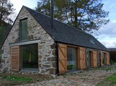 this former horse barn has been brought back to life as a modern home on the banks of Loch Duich in the Western Highlands of Scotland. i lo...