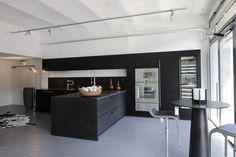 Black And White Kitchen Ideas for Modern Looks of Your Kitchen: Fascinating Black And White Kitchen Pictures With Hot Style Design Images For Your Modern Home Also Elegant Kitchen Table Along With Rounded Minimalist Coffee Table And Contemporary Stools ~ workdon.com Kitchen Design Inspiration
