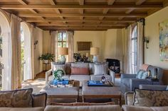 Where coffered ceilings, sweeping arches and sconces showcase the original craftsmanship behind this 1920s Mediterranean-style home, designer Laura Martin Bovard used contemporary colors, accents and furniture to update the interior for modern living. The result is a space that feels both warm and sophisticated.