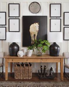 Our favorite kind of mix. Wood console table + black table lamps + horse art over the entryway table + gallery wall in the entryway + black frames with simple white art + styling a console table Large Table Lamps, Black Table Lamps, Entryway Console, Entryway Tables, Console Table, Foyer, Decor Interior Design, Interior Decorating, Decorating Ideas