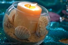 sand, seashells, votive and clear glass holder
