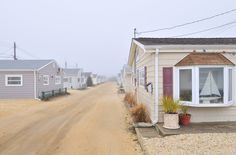 """The first time Douglas Ljungkvist saw Ocean Beach, N.J., it reminded him of a labor camp. It was 1993 his then-girlfriend had suggested they rent a cottage in the Jersey Shore hamlet, as her family had done for years.  I did not want to spend my vacation there,""""  """"It's just rows and rows and rows of these tiny cottages in a line. The streets are made of sand, and it's very sparse. There are telephone poles and wires and a Dairy  Queen, so what?    """"But I gave in and fell in love with the…"""