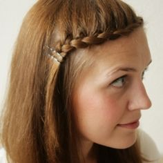 Four ways to braid your bangs and get them out of your face.