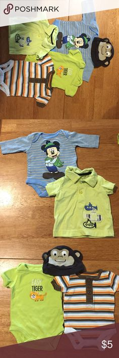 Newborn Lot Boy Clothes w/ one Mickey Mouse Onsie Lot of newborn clothes. 1 long sleeve Mickey Mouse onsies , 2 short sleeve onsies 1 t-shirt and a monkey hat.  May have minimal wear. Disney One Pieces Bodysuits