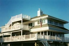 Available for weekly rentals - Cotton Patch Development. Just steps to ocean with views of ocean and bay from the upper deck. Large spacious 7 bedrooms, 4 bath home with central A/C. Decks on 3 levels. Largest deck being on the main level. Screen porch on main level off living room. Tennis available. Remodeled for summer of 2001.