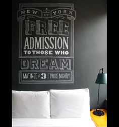 I love the black walls (actually they're chalk board walls).  Dont know about the chalk over the bed, but I love the free admission sign.