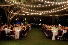 Simple string lights draped throughout this outdoor reception space create such a romantic feel.      Photo:  Stephen Karlisch
