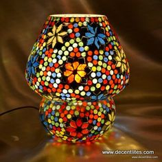 Mosaic Table Lamp  DL10610 Height-23cm Dia-19cm Elegant and Nobel Glass Handicraft Item Meticulous workmanship by expert hands of Professional workers , No child labour More than 20 years experience since 1994 Well and High Quality control Very competitive and unbeatable price Well packed with safety and gift packaging  Fast & prompt delivery  (15- 30 days)	 Reputed Brand name – Decent Lites Decorate your life with romantic atmosphere with family.