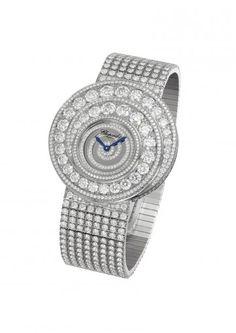 A STYLISH LADY'S DIAMOND WATCH  NEW    Designed as a pavé-set diamond dial within a graduated diamond spiral bezel to the diamond-set bracelet.