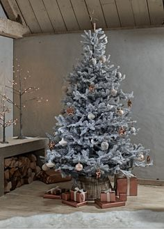 How to decorate your Christmas tree  A frosted Christmas tree is a great alternative to a green style. Add decorations and wrapped presents in gold, copper or brass to bring a bit of warmth and glamour.   Photo: Cox & Cox