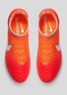 Neon orange Nike futbal shoes