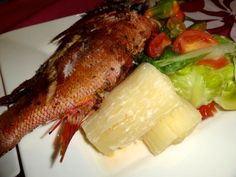 fried fish, cassava and cabbage in coconut milk