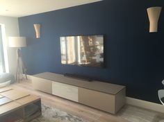 Silk wallpaper with BB Italia to unit & Secto wall lights and gorgeous Rug Company Icat rug