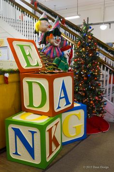 Giant Jack-in-the-Box with clown-like faces on big, moving springs! Sims Furniture Holiday Display, Covington, KY, location. Designed by Dana Burton and Dennis Dix, Deux Design.