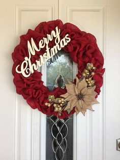 Made with beautiful and bright red burlap, this is the perfect Christmas Wreath!! This wreath measures about 20-21 in diameter. The Merry Christmas sign is hand painted and sits directly above the floral accents, so it can be displayed as is or centered on your door. If there is something