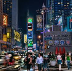 A New York Evening - The crowds in Times Square at night with cars blurring as they pass by.  This is an older shot of mine but I still like it.  What do you think of the blurred effect?