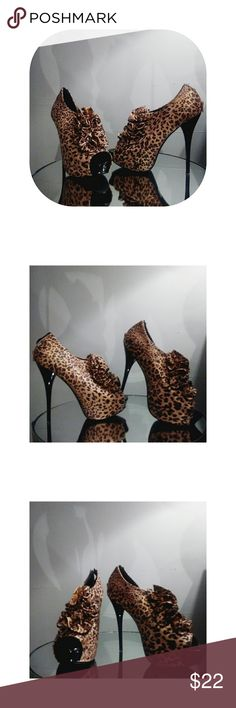 Leopard Print Heels Strut your stuff in these leopard print 5 inch heels with ruffling in the from. Pairs well with jeans, skirts and shorts. Charlotte Russe Shoes Heels