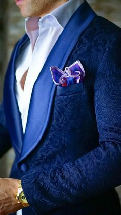 I love the details on his jacket. The color is very handsome, but the details are what make this suit stand out.