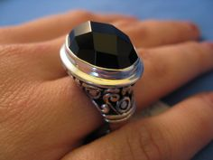 Item # A100-on1725    Beautiful Faceted Onyx ring set in Sterling Silver.  Intricate scroll work around band .  Size 7 1/2    $48.00