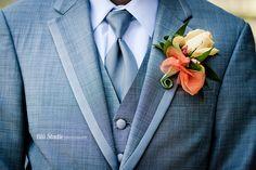 Yellow and orange rose wedding boutonniere.