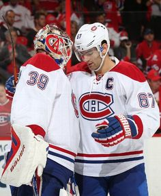 OTTAWA, ON - OCTOBER 11: Mike Condon #39 of the Montreal Canadiens celebrates his first career NHL win with teammate Max Pacioretty #67 after a game against the Ottawa Senators at Canadian Tire Centre on October 11, 2015 in Ottawa, Ontario, Canada. (Photo by Andre Ringuette/NHLI via Getty Images)
