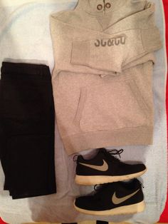Grey hoodie, black skinny jeans, Nike Roshe Runs. This is the sort of outfit I wear to and from football as it is sporty and comfortable.